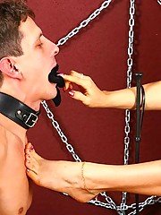 Two dominatrices trample their boy toy�s limp meat, gag his mouth with tights and make him lick their toes