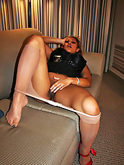 Kinky Maxine X inserts a leg of her pantyhose into her throbbing pussy