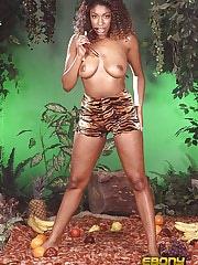 An ebony slut eating tropical fruit in the nude