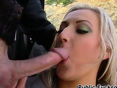 Busty broad eats rod outdoors