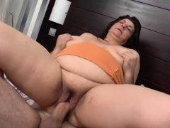 Busty mature in the bed